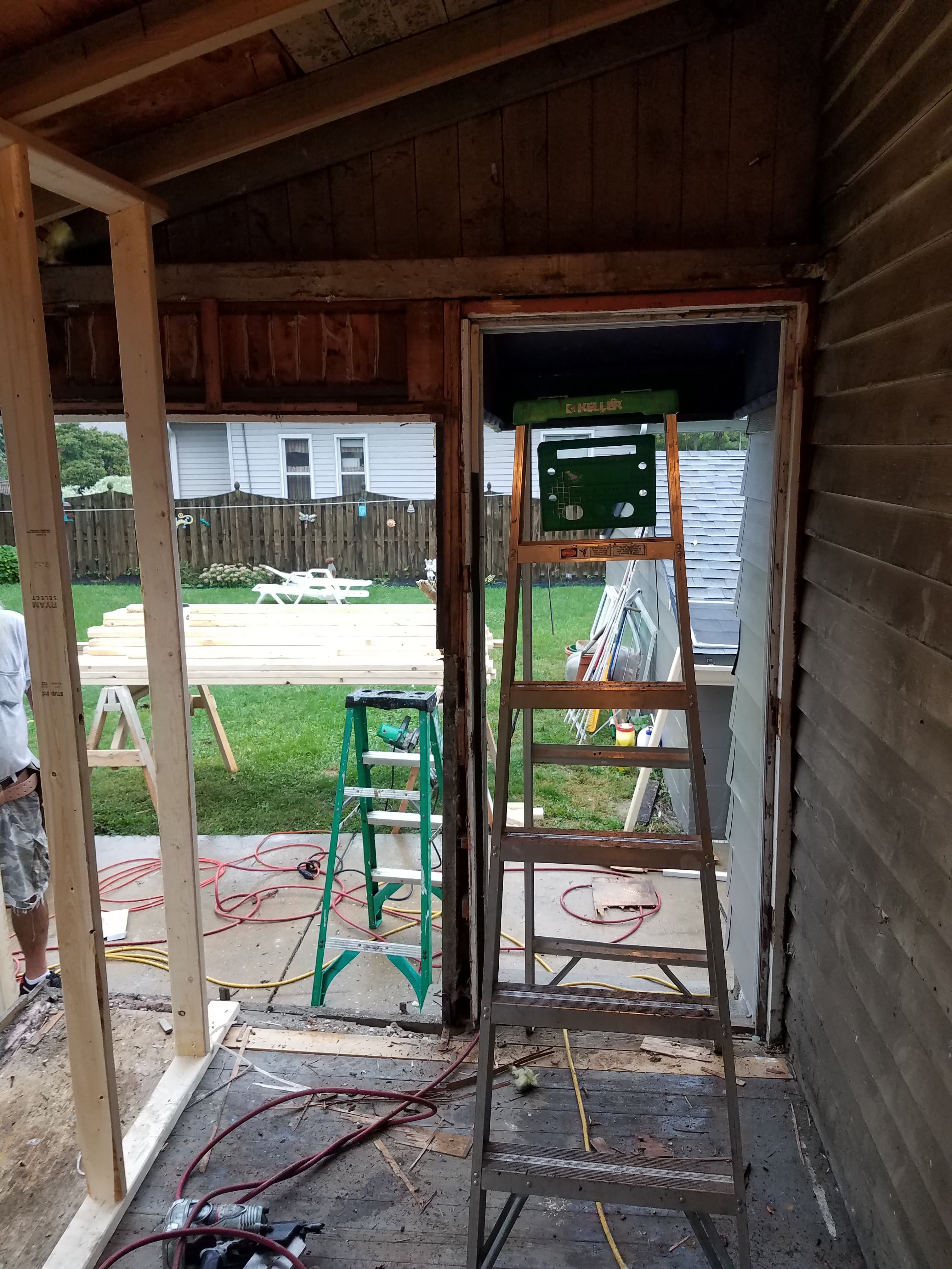 Removal of old entry door and prep for standard size door